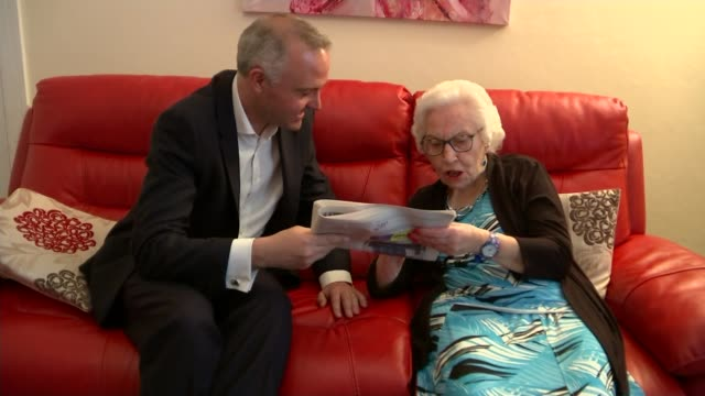 devon pensioner learns to read aged 87; ursula shepherd sits with reporer reading headline from newspaper article about herself sot/ urseula shepherd... - リチャード・パロット点の映像素材/bロール