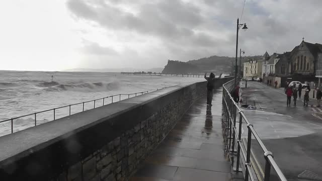 devon was bombarded by huge waves february 5 as stormy conditions continued in the majority of the uk. as martin parked filmed the waves crashing... - drenched stock videos & royalty-free footage