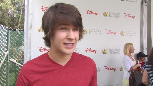 devon werkheiser on why he is attending event at the 21st annual 'a time for heroes' celebrity picnic benefit at los angeles ca - a time for heroes stock videos & royalty-free footage