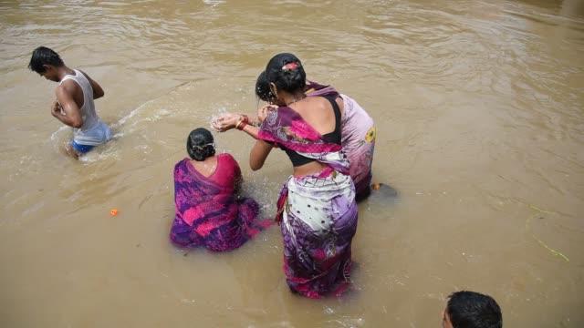 Devotee take holy bath at Kumbh Mela, Nashik