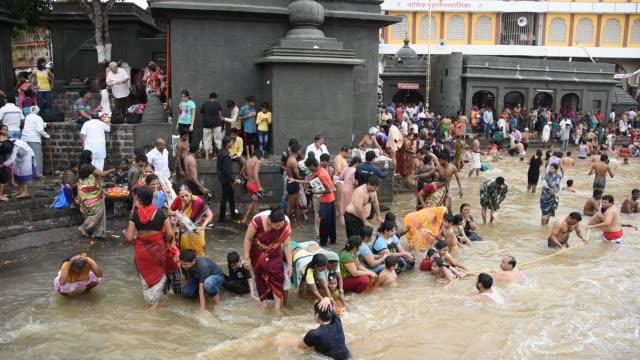 devotee take holy bath at kumbh mela, nashik - customs stock videos & royalty-free footage