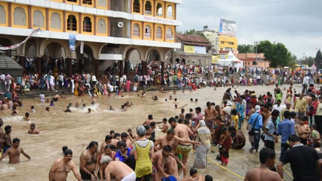 Devotee take holy bath at Kumbh Mela, Nashik