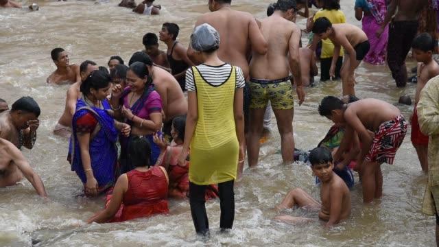 devotee take holy bath at kumbh mela, nashik - river stock videos & royalty-free footage