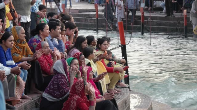 devotees at the banks of river ganges / haridwar is an ancient city and important hindu pilgrimage site where the river ganges exits the himalayan... - acqua santa video stock e b–roll