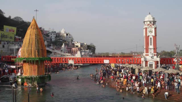devotees bathing in the sacred waters / haridwar is an ancient city and important hindu pilgrimage site where the river ganges exits the himalayan... - foothills stock videos & royalty-free footage