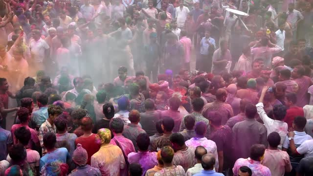 devotees crashing a bamboo at the kirtanghar grounds as a ritual during doul utsav as people throwing coloured powder, amid covid-19 coronavirus... - bamboo plant stock videos & royalty-free footage