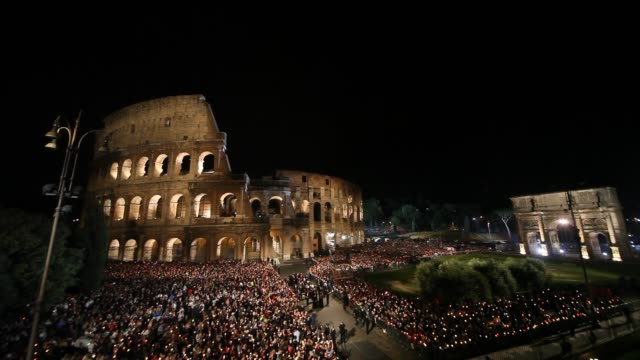 Devotees gather at the Colosseum during the Way of the Cross held by Pope Benedict XVI on April 22 2011 in Rome Italy