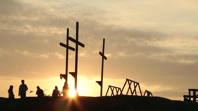 Devotees in the fervently Catholic Philippines mark Good Friday by being nailed to crosses and whipping their backs bloody in extreme acts of...