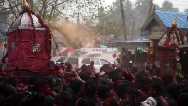 devotees move the three idols around the kirtanghar grounds, during doul utsav as people throwing coloured powder, amid covid-19 coronavirus... - bright colour stock videos & royalty-free footage
