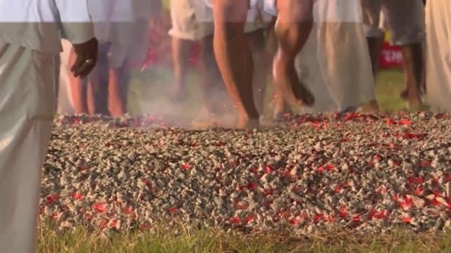 devotees of the jui tui shrine on the tourist island of phuket in thailand walk on burning coal during the nineday taoist nine emperor gods festival... - phuket stock videos & royalty-free footage