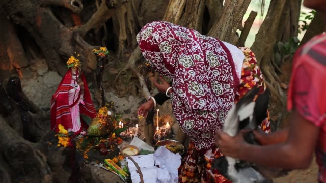 Devotees pray and offer their oblations to their goddess seeking release of their illness in Dhaka Bangladesh on January 14 2016 From elder to child...