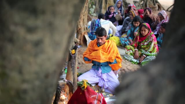 devotees pray and offer their oblations to their goddess seeking release of their illness in dhaka bangladesh on january 14 2016 from elder to child... - goddess stock videos and b-roll footage
