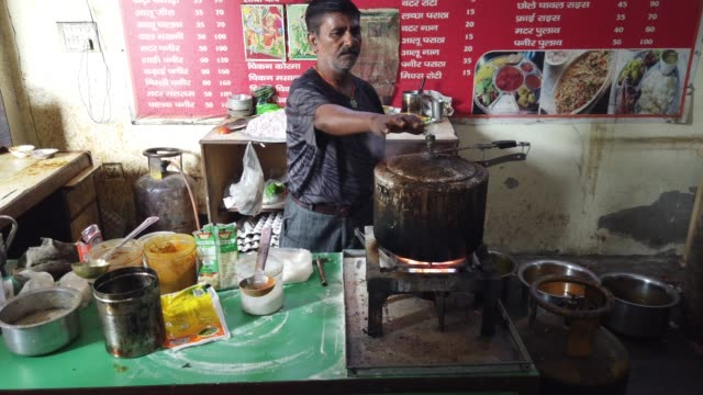 vídeos de stock, filmes e b-roll de dhaba is a roadside restaurant in the indian subcontinent they are on highways generally serve local cuisine both vegetarian and nonvegetarian and... - savory food