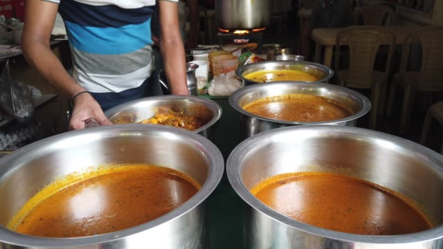 dhaba is a roadside restaurant in the indian subcontinent they are on highways generally serve local cuisine both vegetarian and nonvegetarian and... - curry powder stock videos and b-roll footage