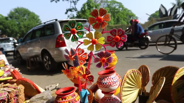 dhaka 10 april 2016 vendors have kept different types of colorful handy itemspottery toys and bamboo made products to attract buyers ahead of the... - craft product stock videos and b-roll footage