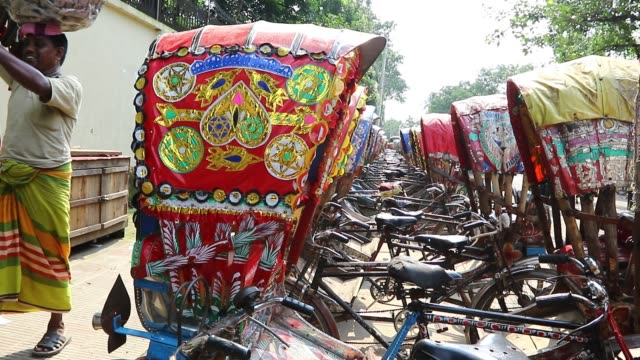 Dhaka 21 June 2018 During Eid vacation a line of tricycle rickshaws is parked on a roadside at Dhaka This year more than six and half million people...