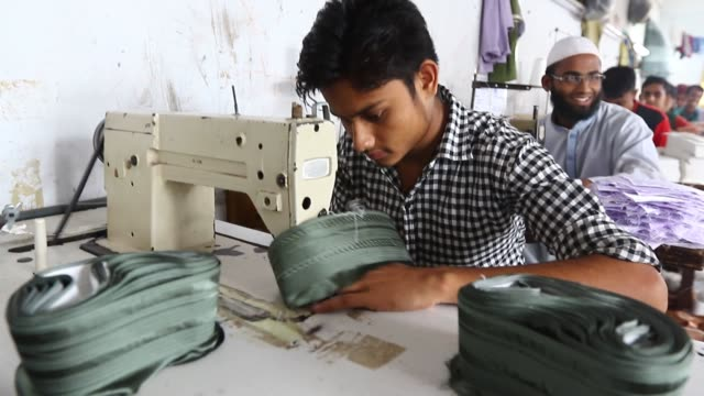 dhaka 22 june 2016. worker sews islamic caps in the al-hedaya cap garments in dhaka. the islamic cap is one of the most important things for all... - garment stock videos & royalty-free footage