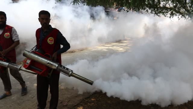 Dhaka Bangladesh 28 feb 2018 An employee of Dhaka North City Corporation sprays pesticide for kill mosquitoes at Dhaka university area