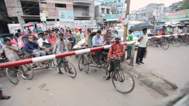 Dhaka slums alongside rail tracks viewed from a moving train,  Dhaka, Bangladesh, Indian Sub-Continent, Asia