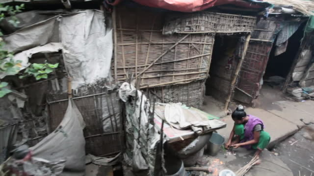dhaka slums alongside rail tracks viewed from a moving train,  dhaka, bangladesh, indian sub-continent, asia - slum stock videos & royalty-free footage