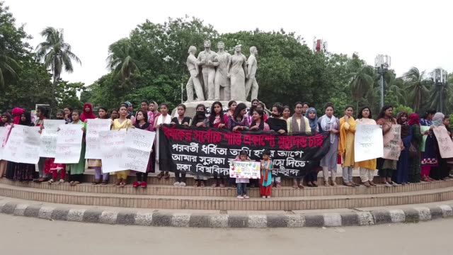dhaka university students shout slogan as they take part in a protest against recent rape incidents across the country in dhaka bangladesh july 10... - todesstrafe stock-videos und b-roll-filmmaterial