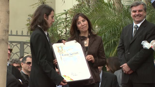 dhani harrison and olivia harrison at the george harrison receives star posthumously on the hollywood walk of fa at hollywood ca. - george harrison stock videos & royalty-free footage