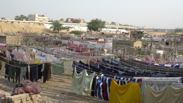 dhobi ghat, the washing wharf on the banks of the lyari river in karachi, pakistan - pakistan stock videos & royalty-free footage