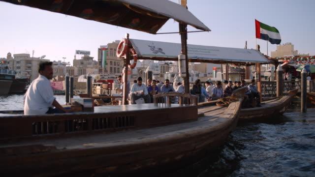 dhow boat crossing dubai creek - marina stock videos & royalty-free footage