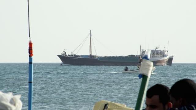 ws pan dhow passing through sea / sur, oman  - ダウ船点の映像素材/bロール