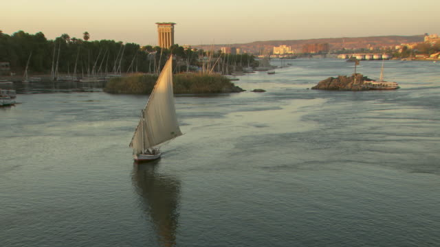 vidéos et rushes de a dhow sails along the nile near aswan in egypt.  - égypte