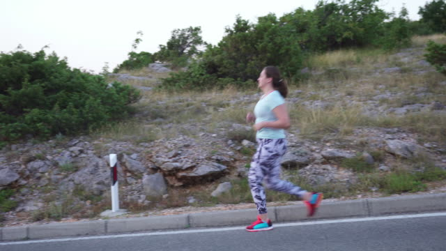 diabetic woman running outdoors in nature - type 1 diabetes stock videos & royalty-free footage
