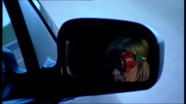 diabetics face losing driving licences due to eu ruling england int sequence reporter sitting in car wearing goggles as taking part in driving test... - skibrille stock-videos und b-roll-filmmaterial