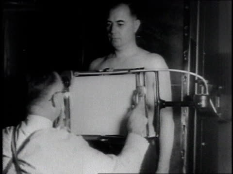 1946 montage diagnosing lung disease / united states - brustkorb menschlicher knochen stock-videos und b-roll-filmmaterial