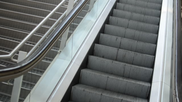 diagonal capture of an escalator - market retail space stock videos and b-roll footage