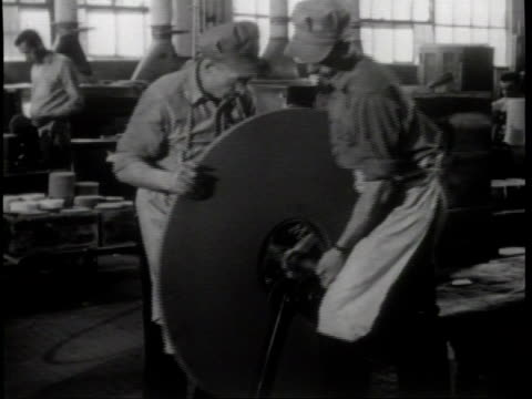 a rpm dial goes up / a wheel spins during a balance test / workers inspect a wheel / a laborer grinds on a cog / machines polish metal / narrated - narrating stock videos & royalty-free footage