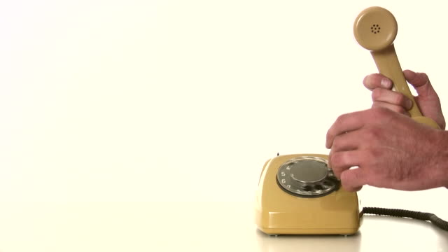 dial phone number communication - telephone receiver stock videos & royalty-free footage
