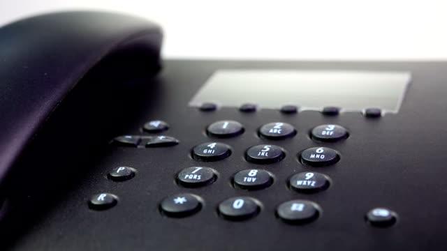 vídeos de stock e filmes b-roll de marcar um número - telefone sem fio