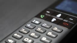 Dialing keyboard of modern cordless phone hi-tech design in office 4K