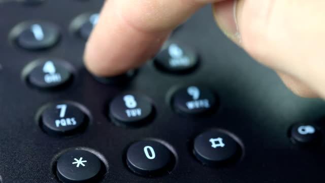 dialing number on a phone - sladdlös telefon bildbanksvideor och videomaterial från bakom kulisserna