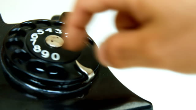 dialing number on a phone - analog stock videos and b-roll footage