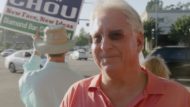 Diamond Bar CA – Citizens rally at Diamond Bar's busiest intersection to encourage voter turnout in the November 6 2018 General Election Major local...