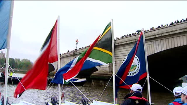 diamond jubilee pageant 2012: 13.00 - 13.30; cruise boat on river / hms belfast / floral arrangement on board spirit of chartwell / commonwealth... - hungerford bridge stock videos & royalty-free footage