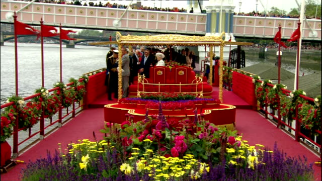 diamond jubilee pageant 2012; side view trumpeters playing sot queen and prince philip on barge of the royal yacht britannia at chelsea pier barge... - barge stock videos & royalty-free footage