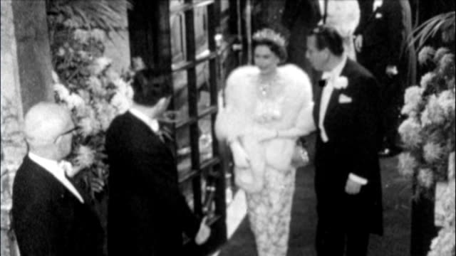 diamond jubilee preparations / vs301062005 queen elizabeth shaking hands with cliff richard at royal variety performance - 1962 stock videos and b-roll footage