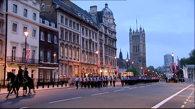 london various of british troops marching along whitehall during daen rehearsal for diamond jubilee carriage procession dawn ends royal carriage... - hampshire stock-videos und b-roll-filmmaterial