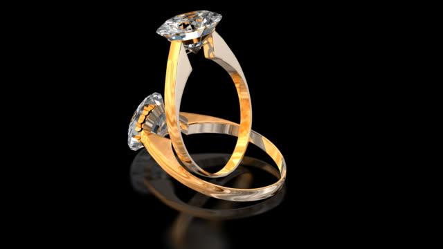 vídeos de stock e filmes b-roll de alianças de diamante - anel joia