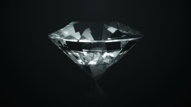 4k diamond rotating on black  background  (loop) - art and craft stock videos & royalty-free footage