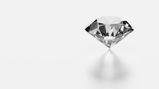 diamond rotating on white background with copy space - stone object stock videos & royalty-free footage
