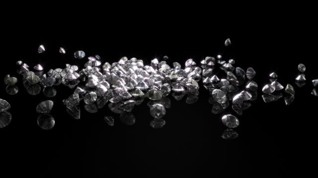 diamonds(w/glow) cascade onto reflective surface - large group of objects stock videos & royalty-free footage