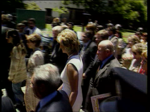 Patric Jephson interview LIB Diana Princess of Wales along on walkabout as hands card to aide Patrick Jephson walking behind her ITN LIB Diana as...